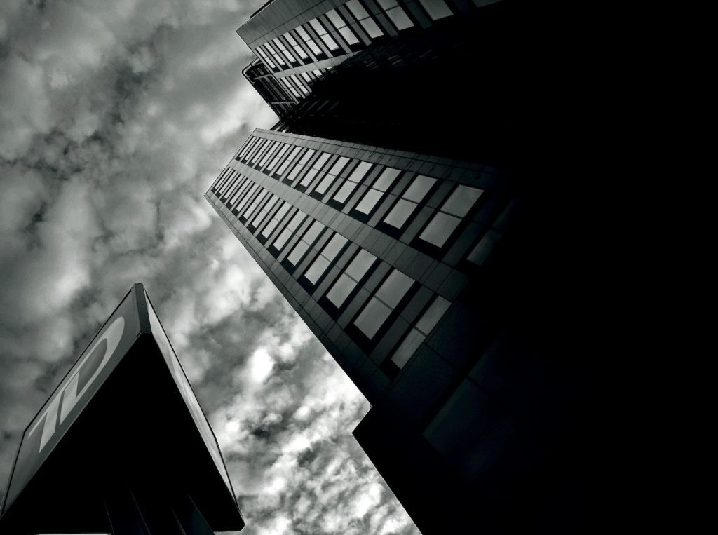 Black and white photo of sky and buildings