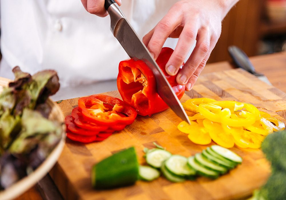 Chef preparing vegetables for salad