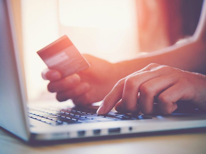 Woman using her credit card