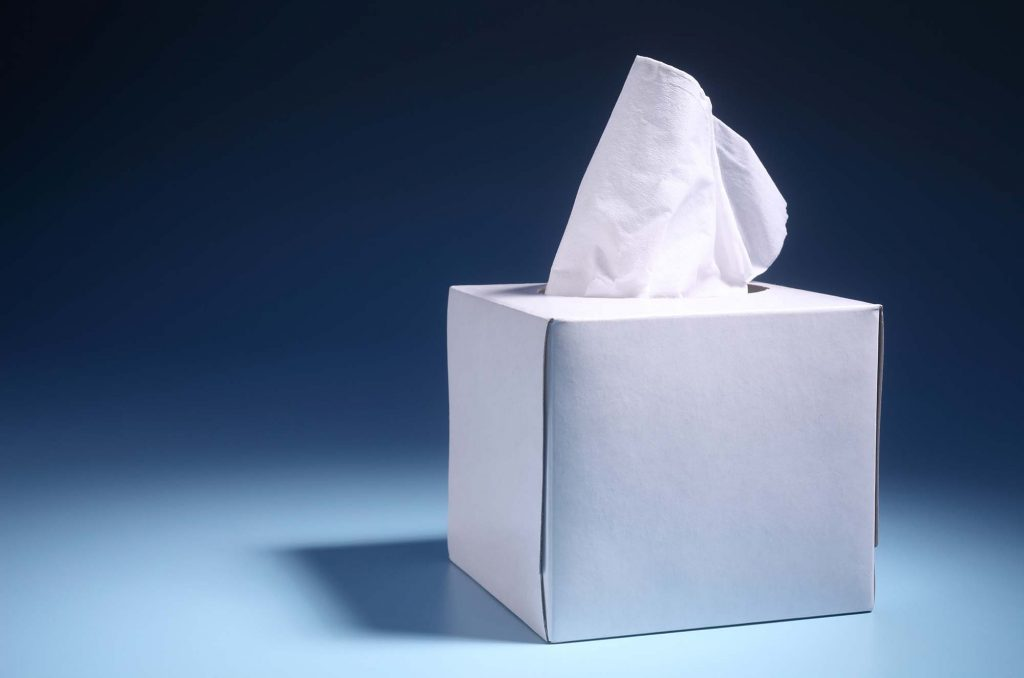 Tissue box against blue background