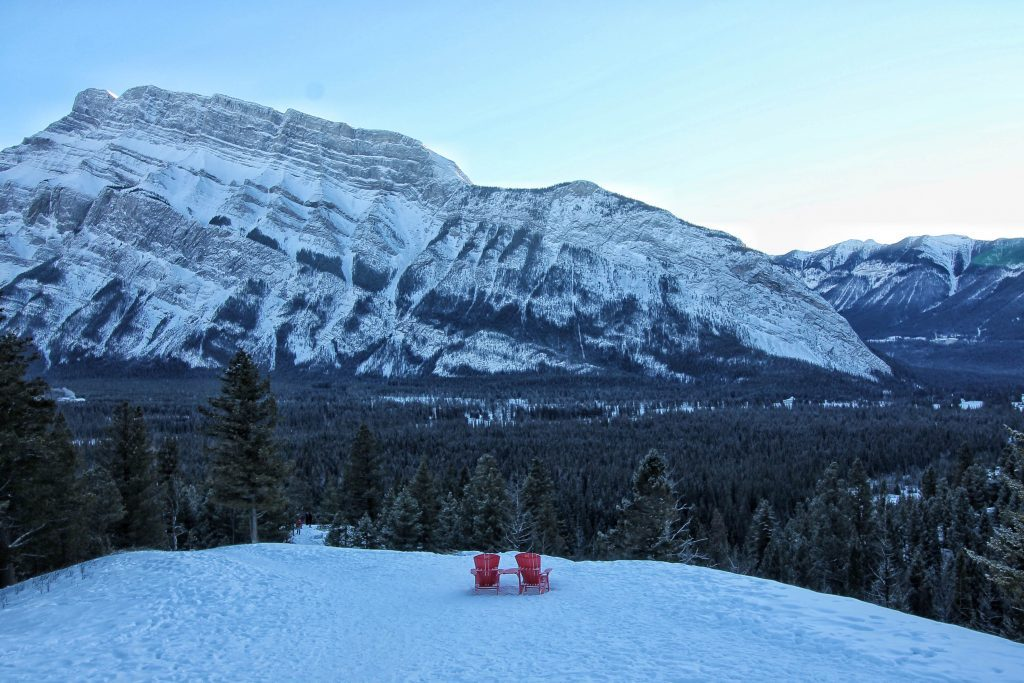 Red deck chairs overlooking Rocky Mountains