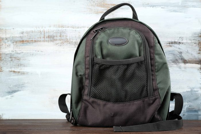 Backpack on wooden table