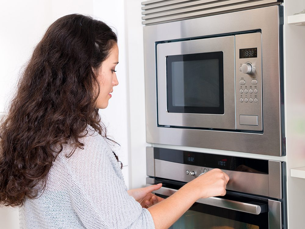 Woman testing oven