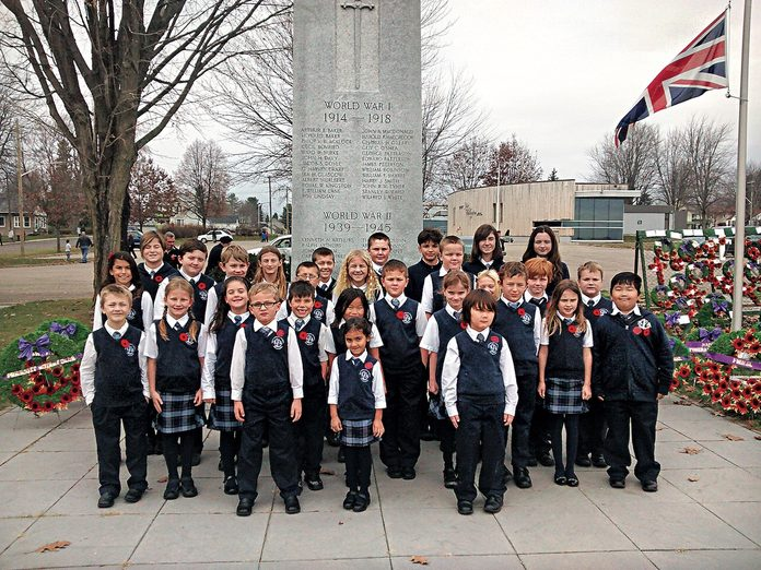 St. Lawrence Academy students at the cenotaph