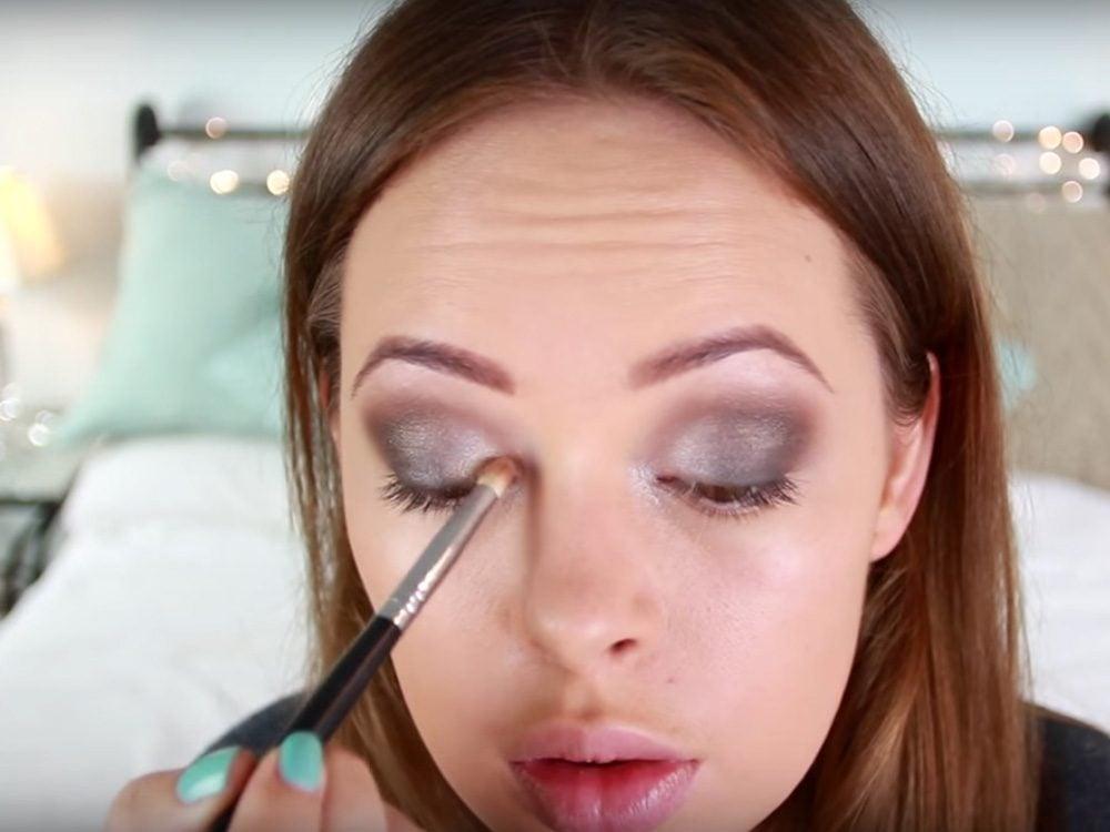 Woman applying smoky eye