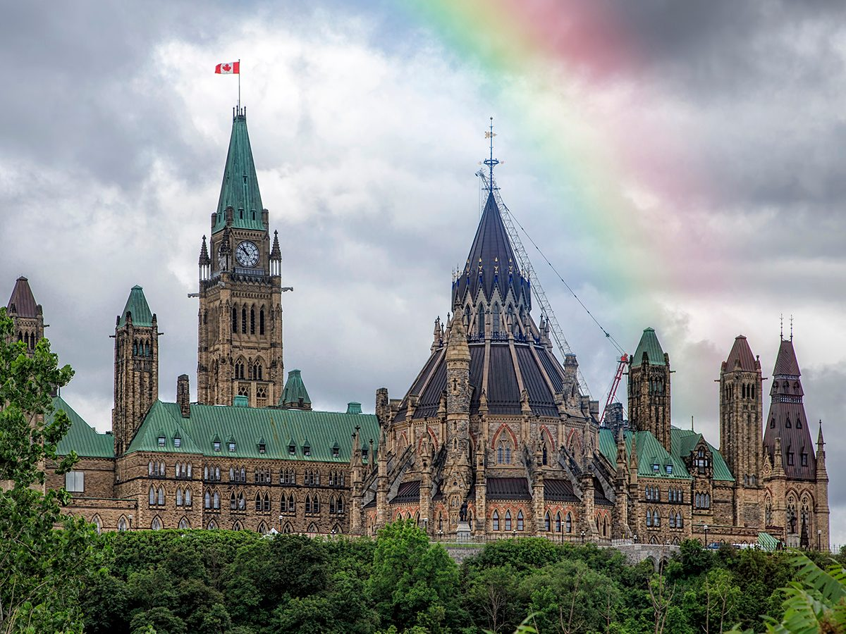 Rainbow photography - Canadian Parliament buildings in Ottawa with rainbow