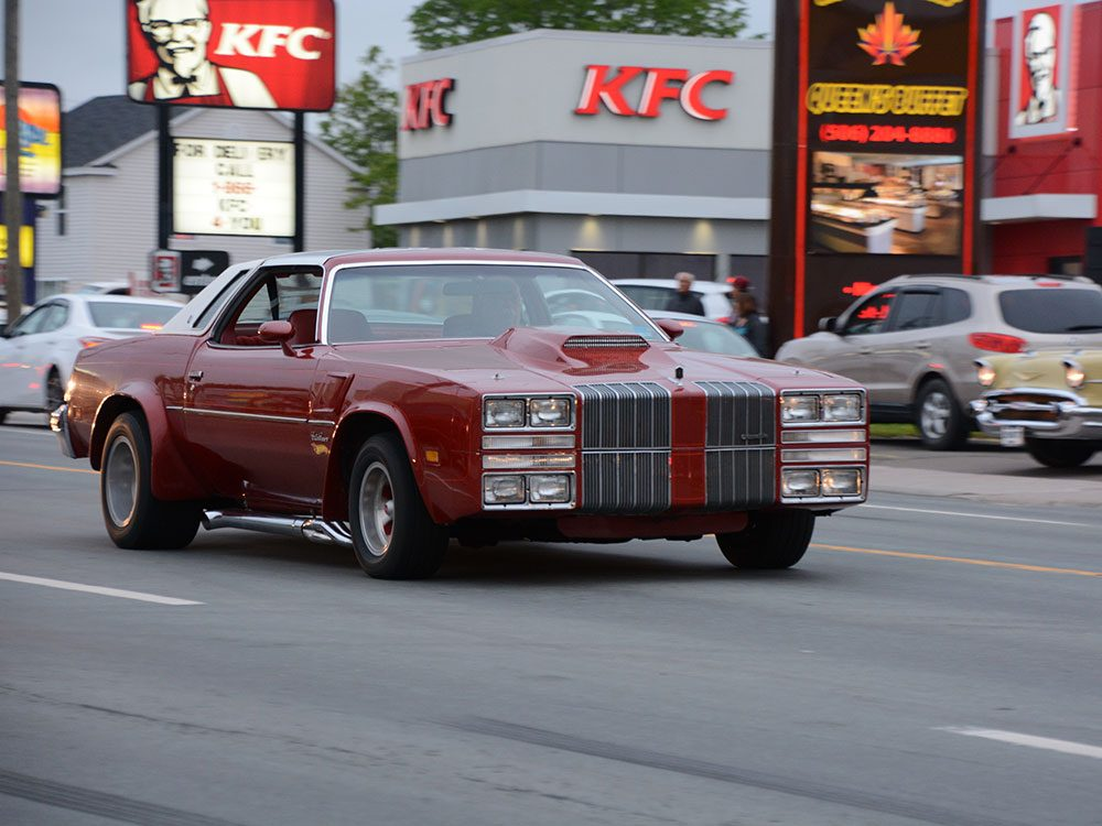 70s car driving down street
