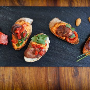 Chorizo Tapas with Roasted Red Pepper Sauce