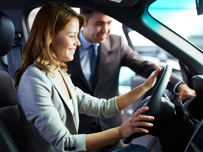 The Best Time to Buy a Car in Canada - car salesman