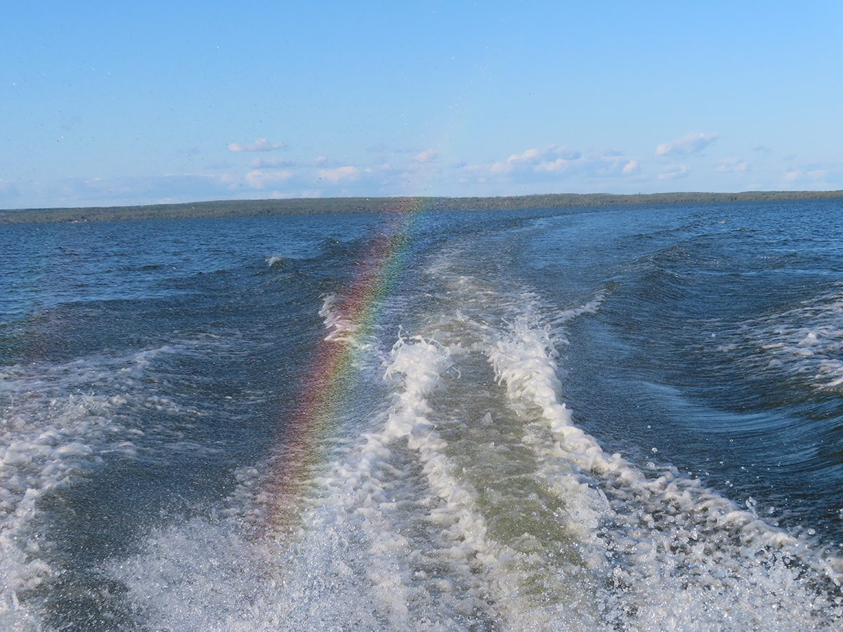 Rainbow photography - boat spray rainbow