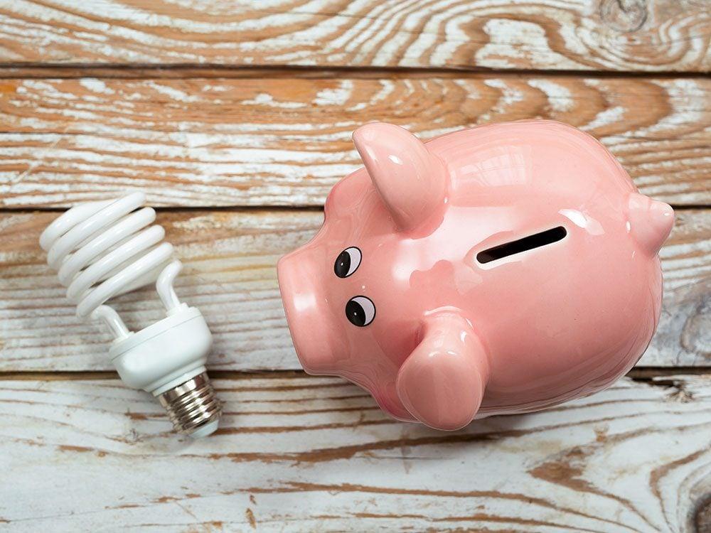 Piggy bank and lightbulb