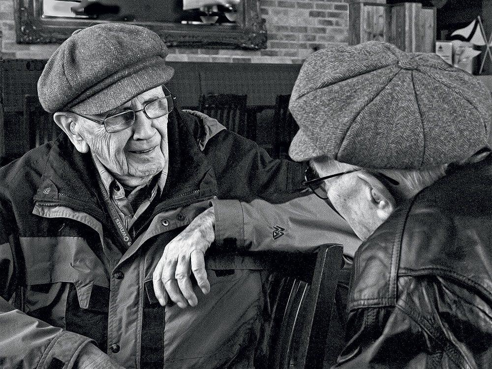 Two veterans talking in restaurant