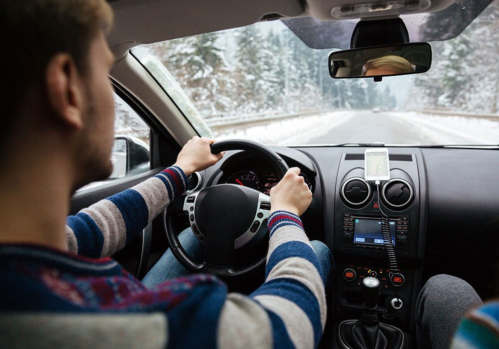 Man driving in winter