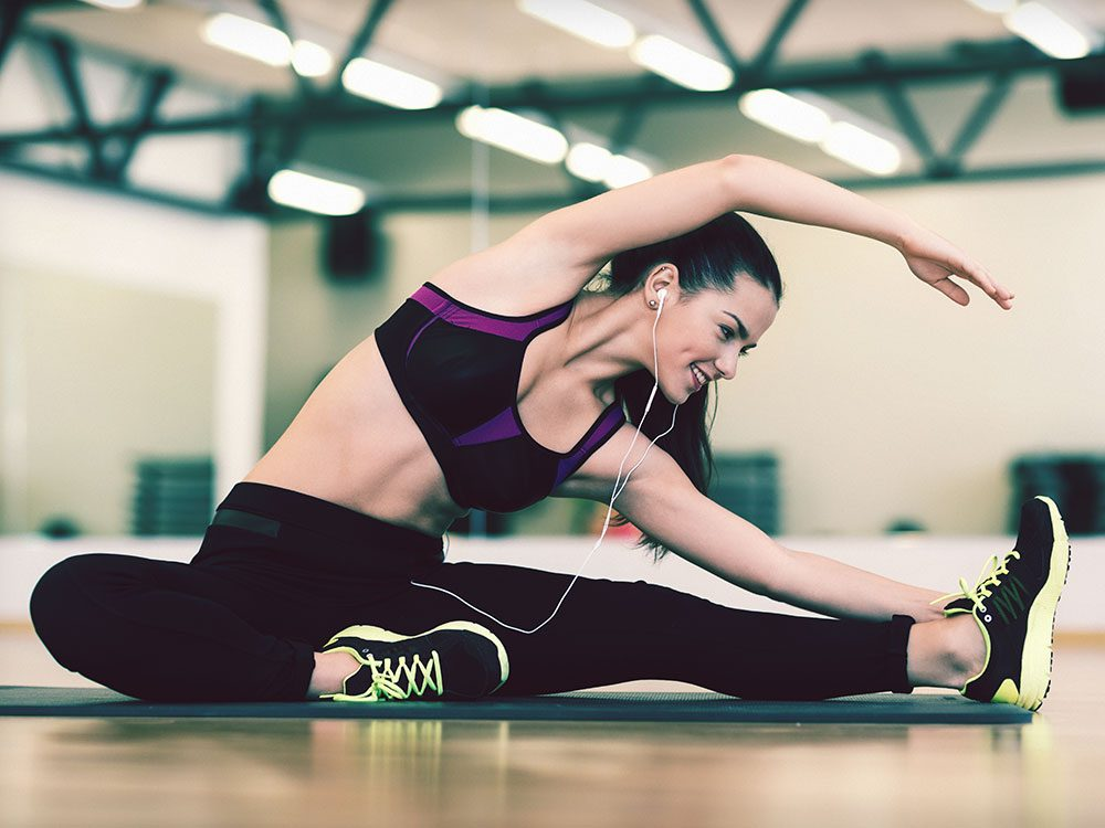 Woman stretching at gym