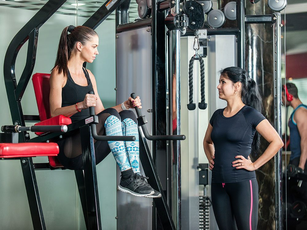 Woman and manager at gym