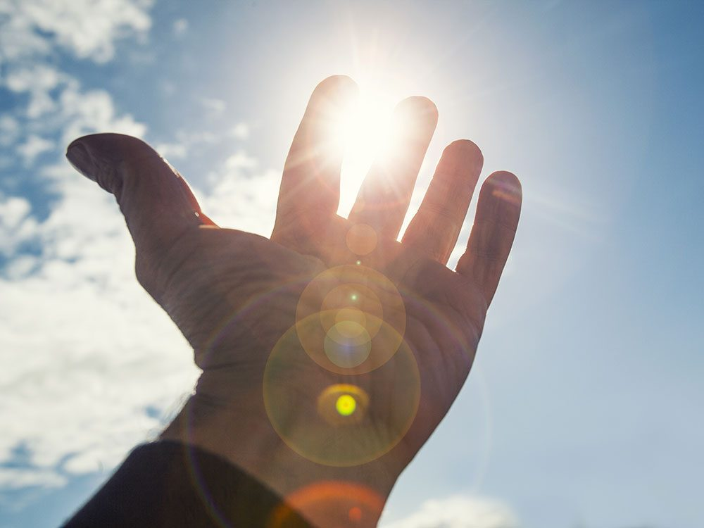Hand in front of sun