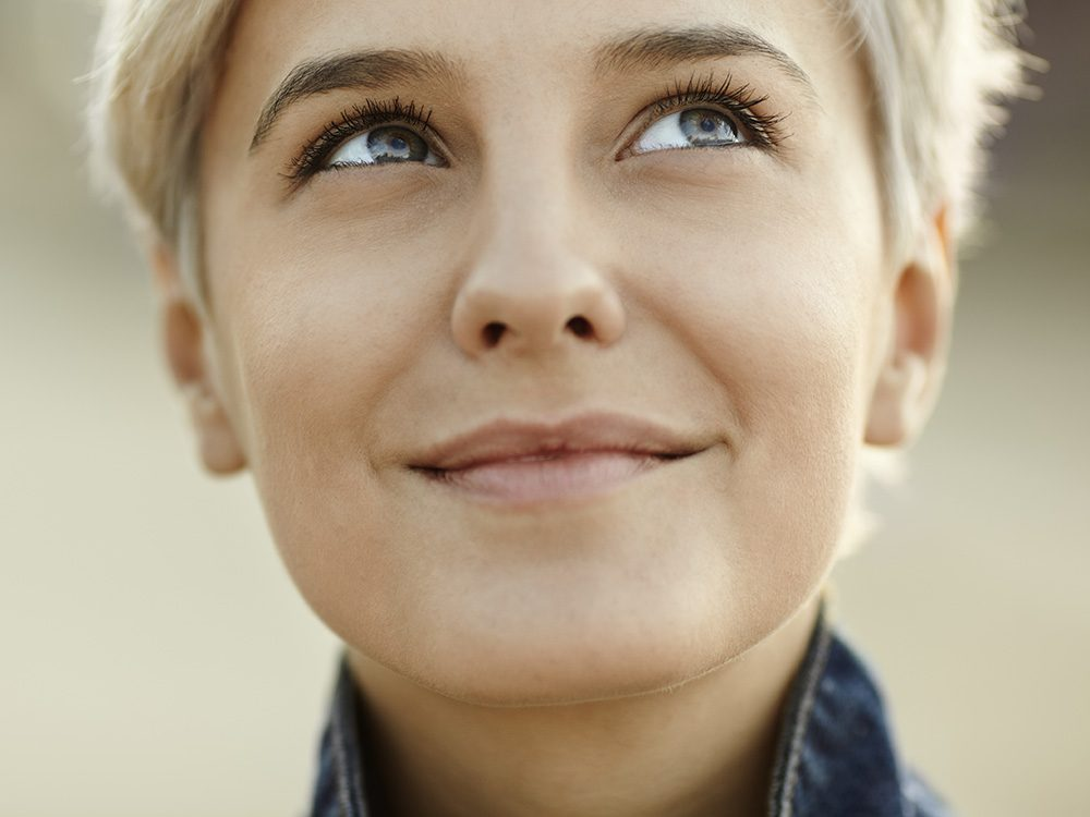 Happy blonde woman smiling