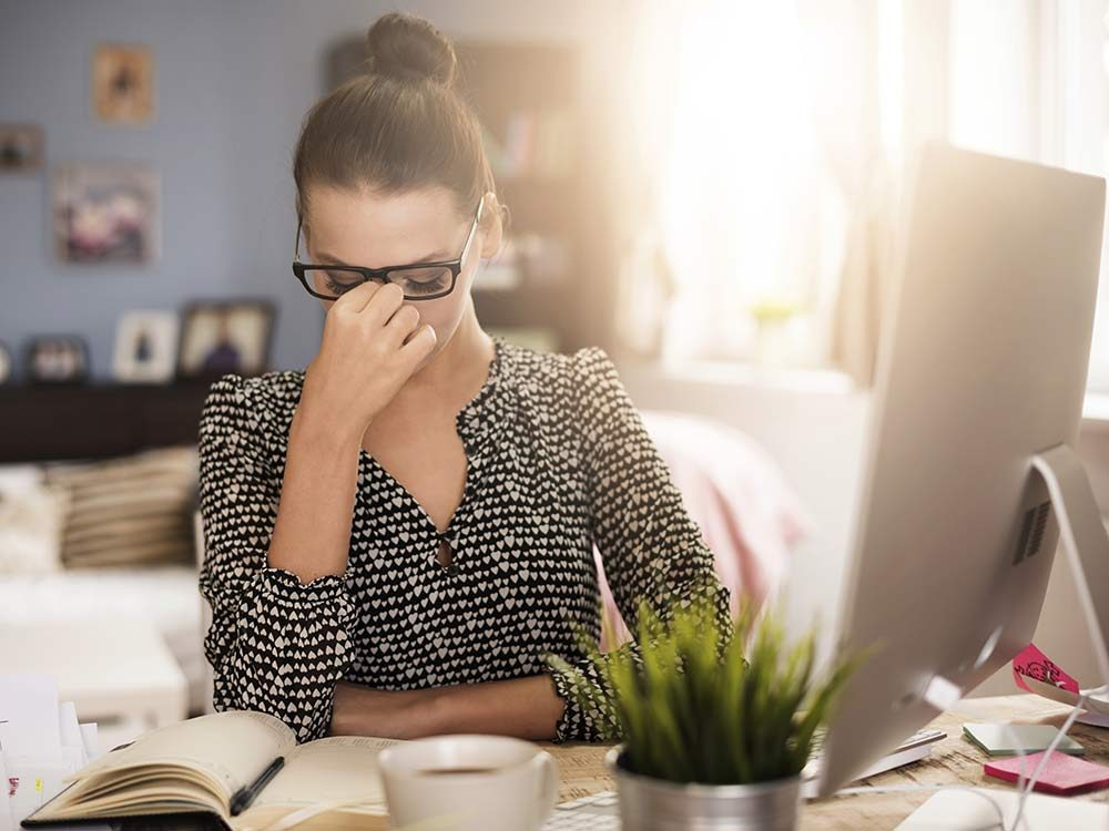 Woman at work with headache