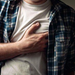 Man experiencing heartburn