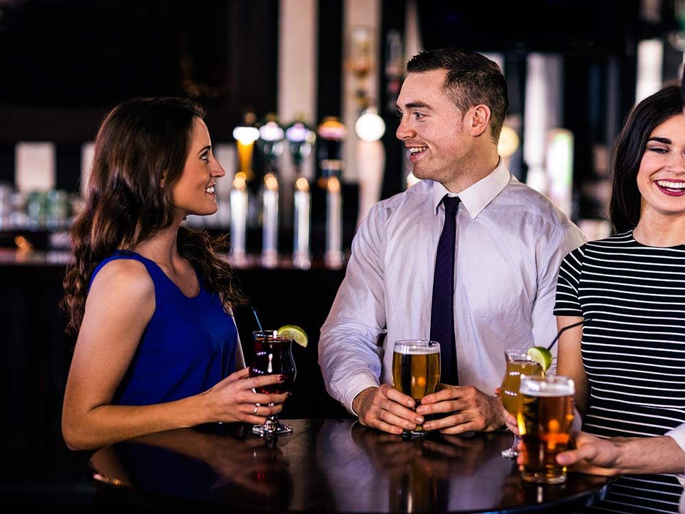 Man and woman flirting at a bar
