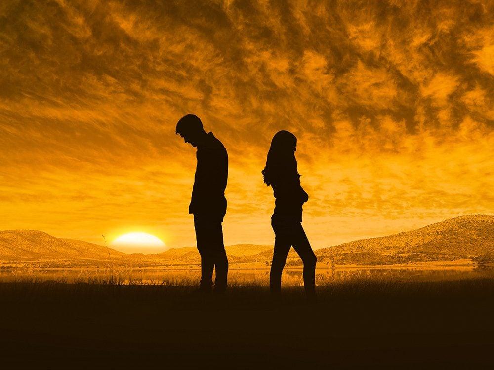 Sad couple against sunset