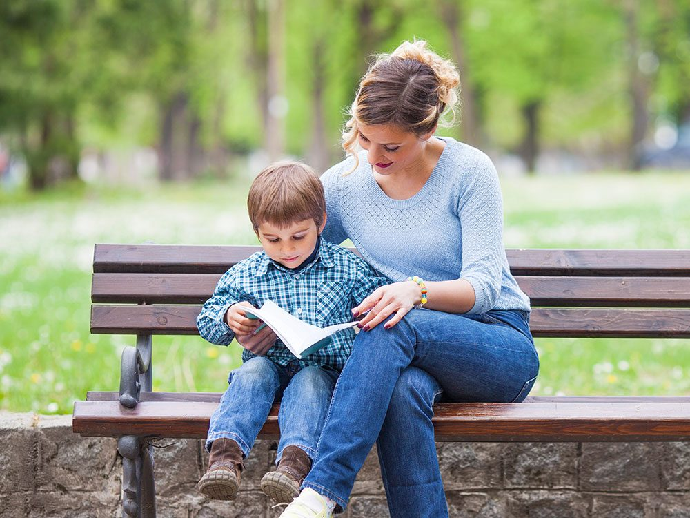 Mother and son reading Reader's Digest