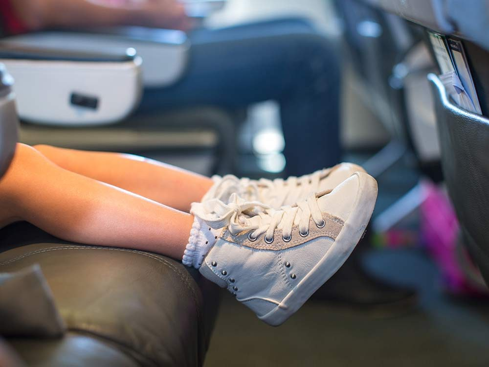 Baby feet on seat in airplane