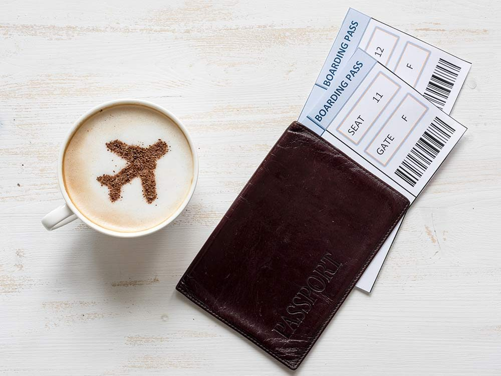 Coffee with passport and boarding passes