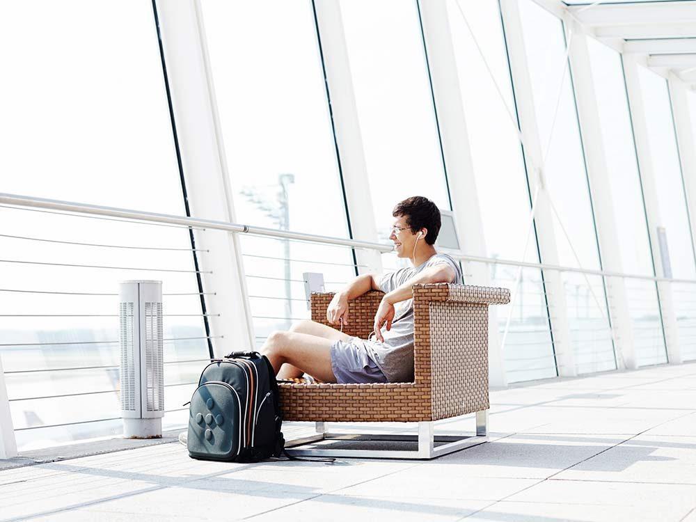 Man in shorts waiting at airport