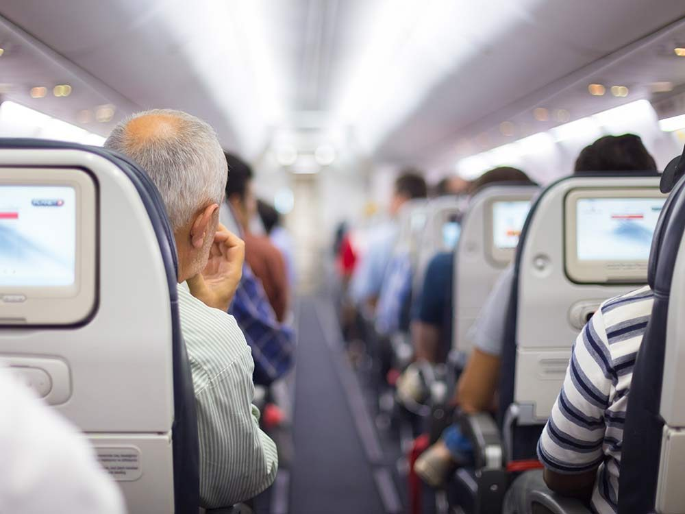 Passengers seated on airplane flight