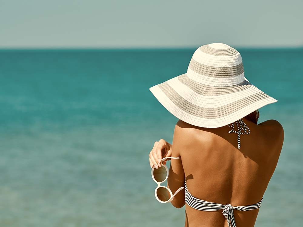 Tanned woman on beach