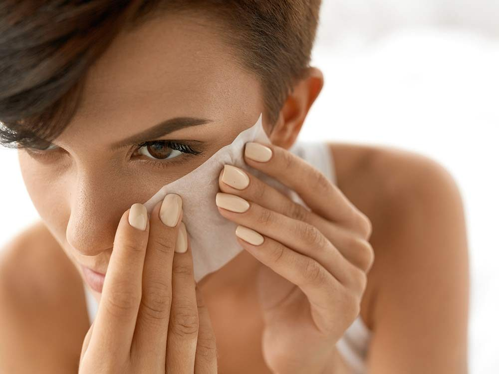 Woman using blotting papers