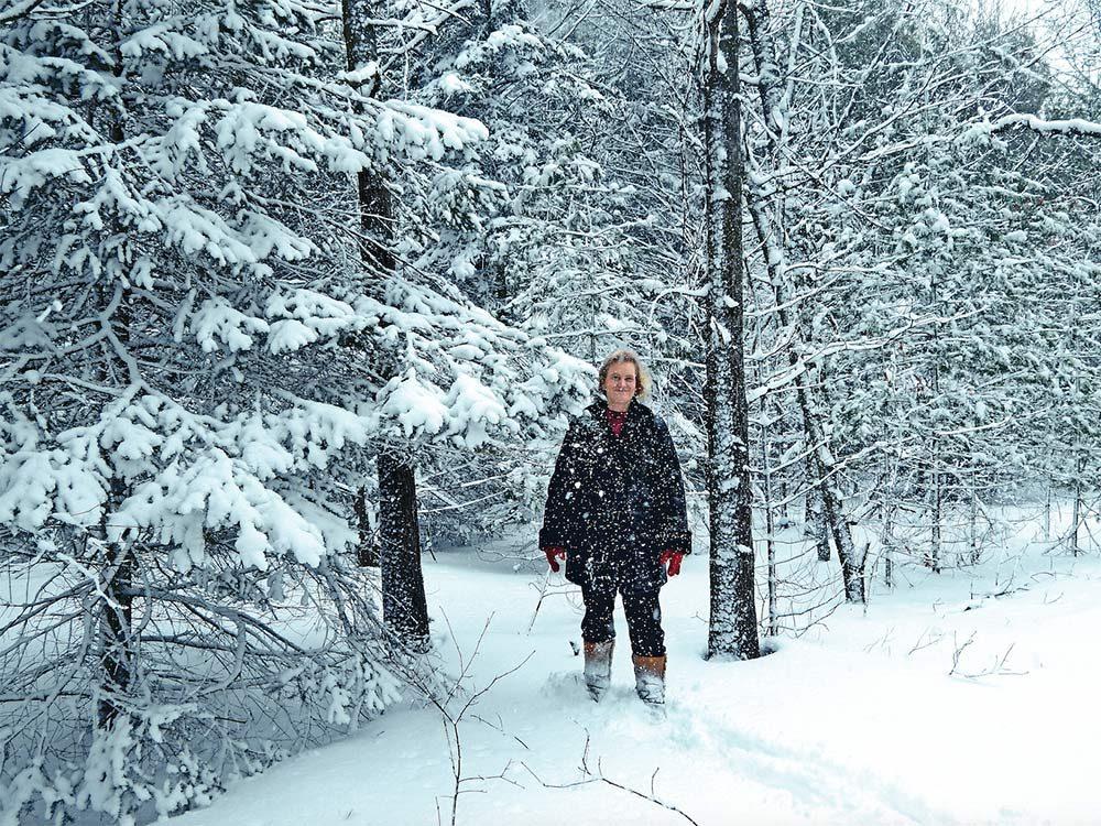Woman in snowy woods in Trenton, Ont.