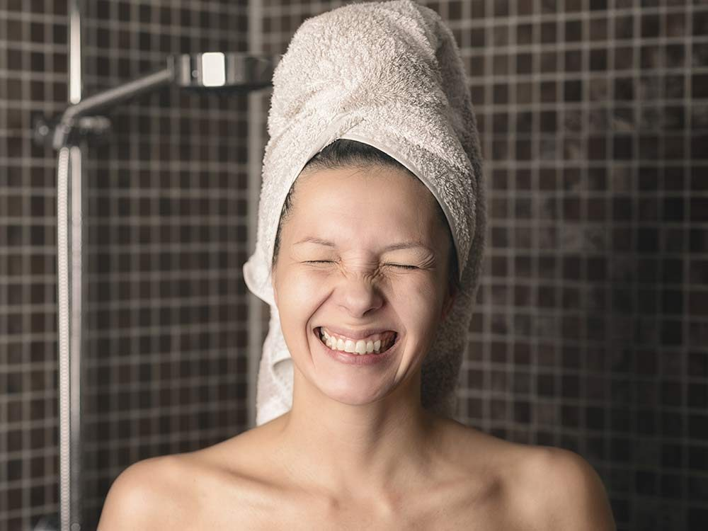 Woman with towel wrapped around her wet hair