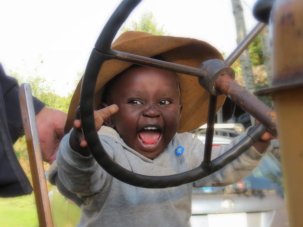 Little boy playing with tractor