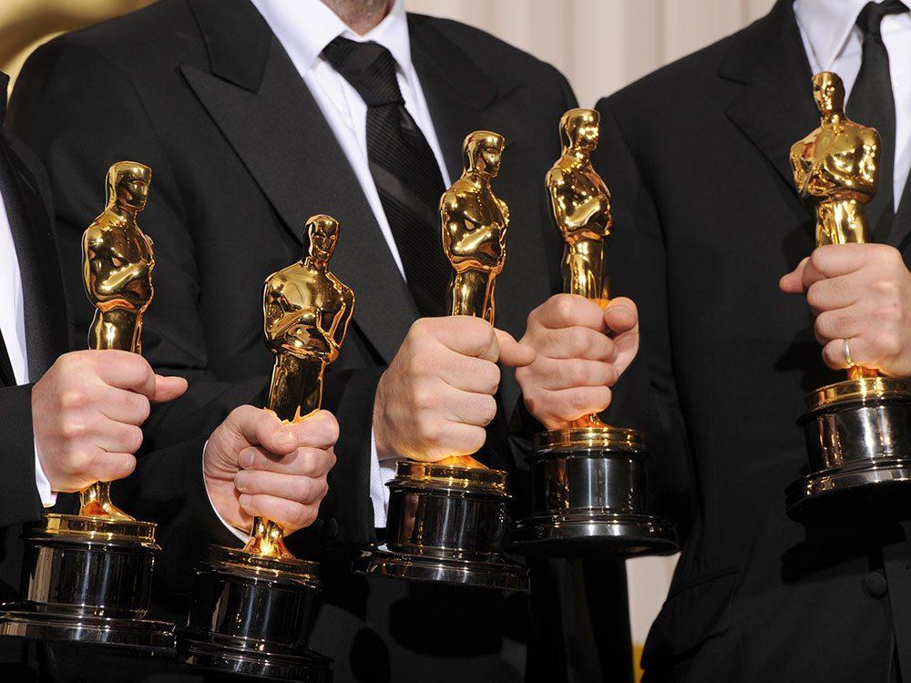 Five Oscar statuettes