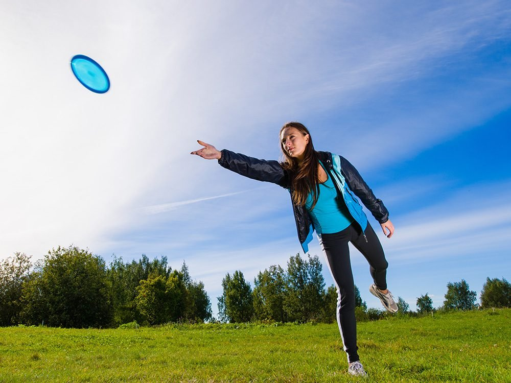Woman playing with frisbee