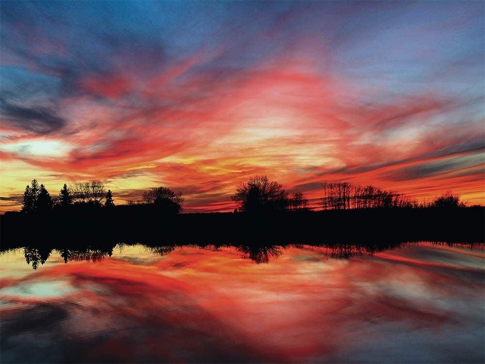 Sunset near slough in Saskatchewan