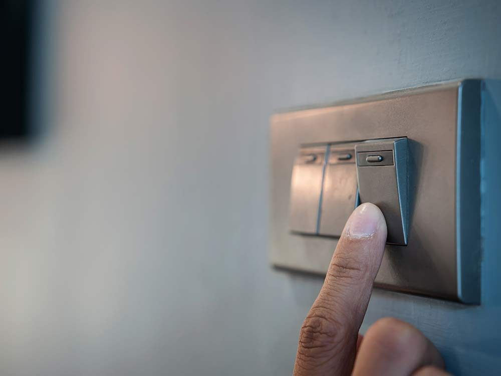 Finger turning off light switch