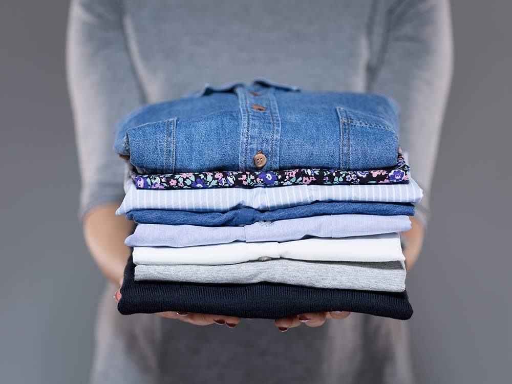 Woman with folded clothing
