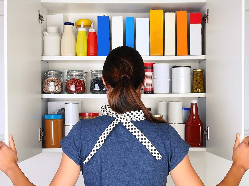 Woman looking in her pantry