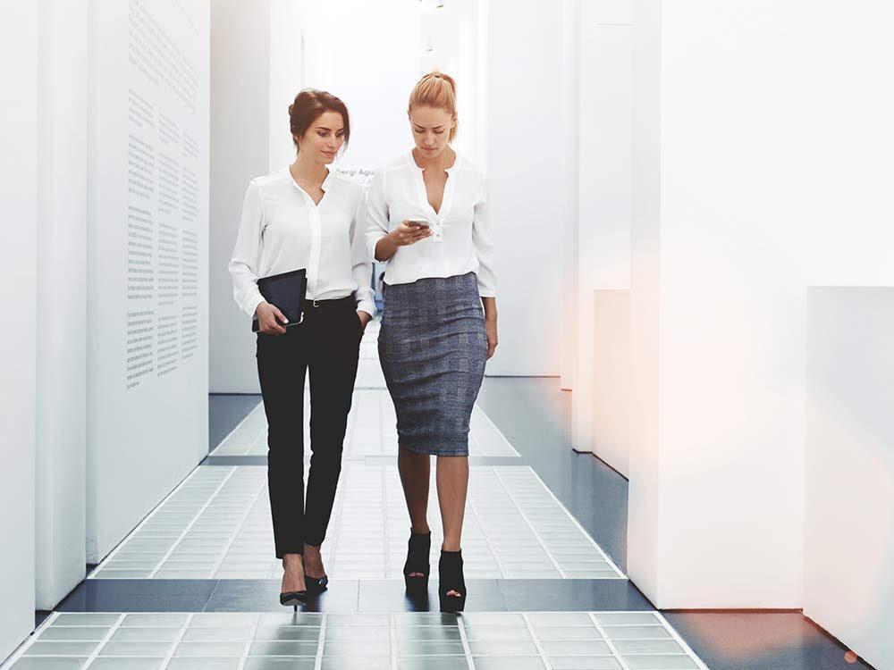 Two businesswoman walking