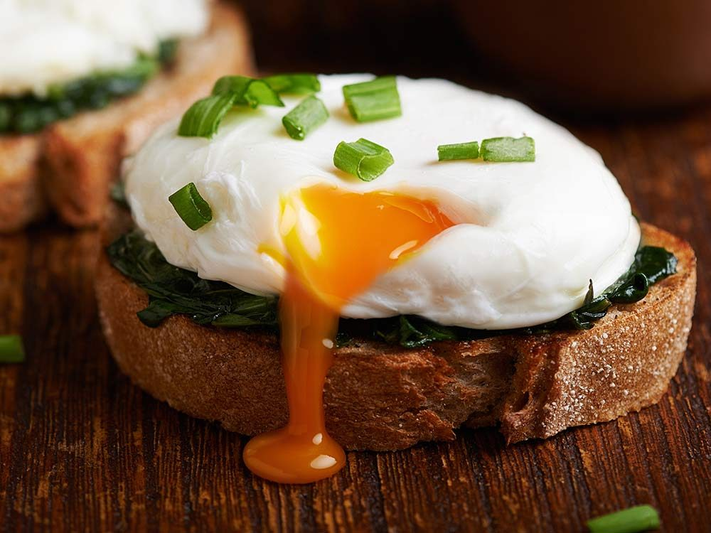 Poached eggs on toasted bread and spinach