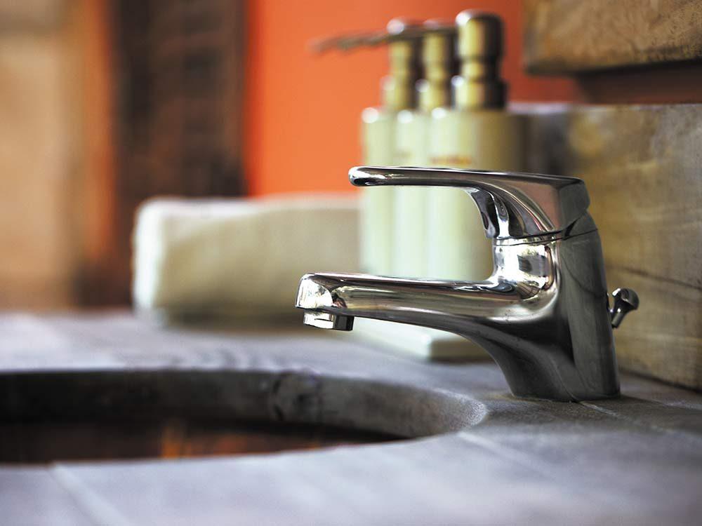 Bathroom sink with wood furnishings