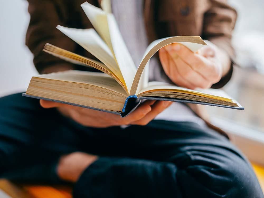 Man flipping through book