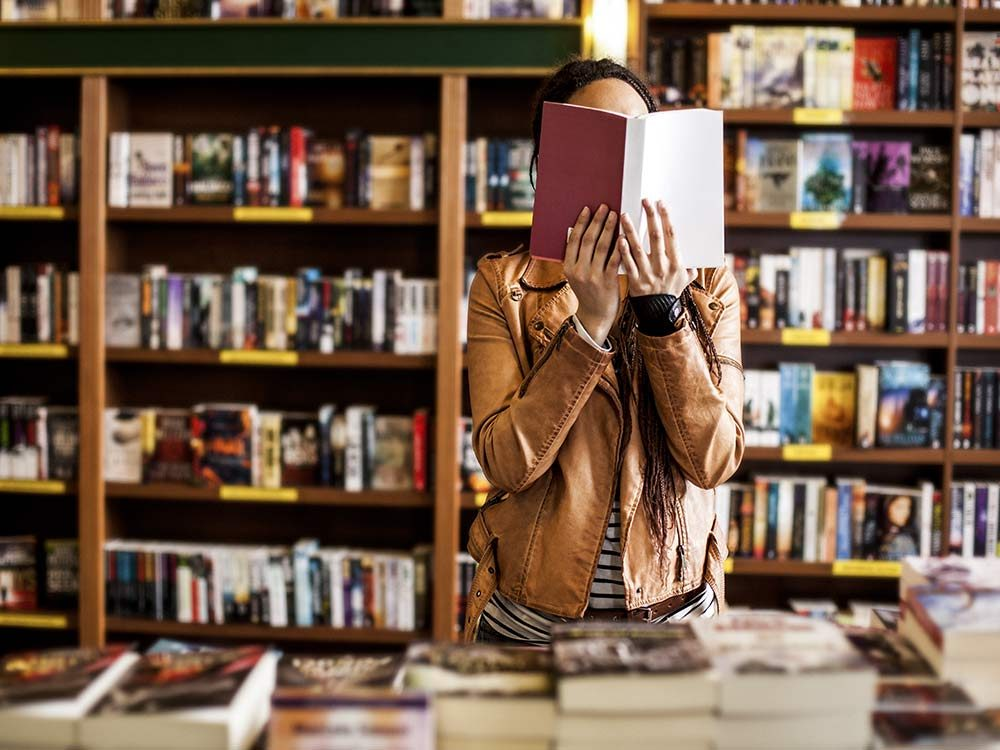 Woman reading a book in bookstore