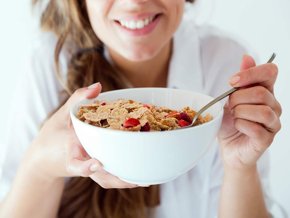 Woman eating a bowl of cereal