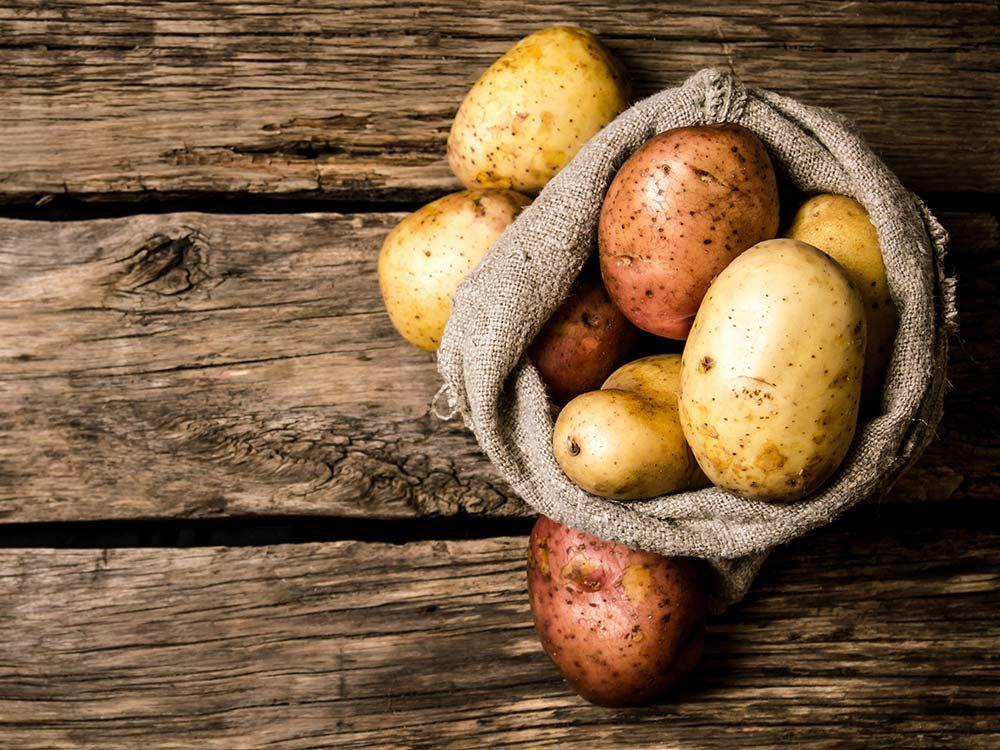 Raw potatoes in sack