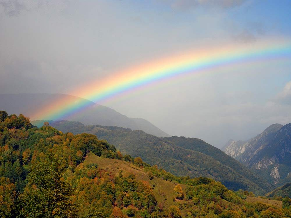 Rainbow over mountains