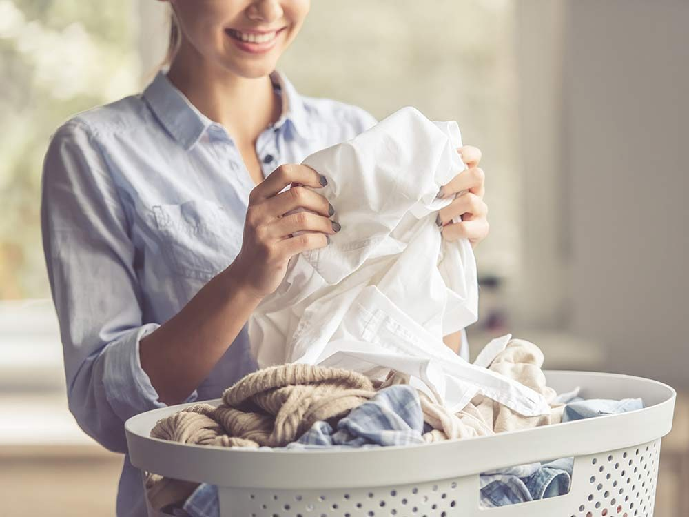 Woman folding clean laundry